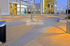 Bomanite Integral Color with two-tone coloration was used here to create a unique paving option that will provide longevity and durability of color and features an interior checkerboard pattern that was inspired by the Daytona International Speedway racetrack infield.