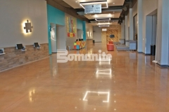 Featured here is Bomanite Patene Teres custom polished concrete flooring that is extremely durable with beautifully distinctive detail that creates a warm, inviting feel in this space.