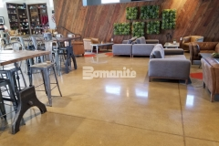 Patene Teres by Bomanite is featured here and the beautiful, custom polished finish is a perfect complement to the contemporary design in this space while providing resistance to slipping, abrasion, and impact, making it the perfect choice for this high traffic area.