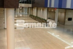 Bomanite Renaissance Deep Grind custom polished concrete was installed at Olathe West High School, creating a two-inch thick unbonded and polished concrete topping slab with local aggregates that were exposed during the grinding process and polished to add a semi-gloss finish.