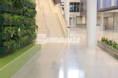 The Bomanite Renaissance Deep Grind process was utilized here to create a flooring surface where the fully exposed hard aggregates are the predominate wear surface, which allows the floor to wear naturally, supports superior stain resistance, and provides a high-end, customizable decorative concrete surface.