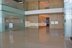The Bomanite VitraFlor Custom Polishing System was used here to create a beautiful, decorative concrete flooring surface and this 1,500-grit polish and salt and pepper finish add distinctive detail and sheen that fit perfectly inside the Cypress Waters Business Complex.