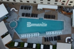 Bomanite of Tulsa, Inc. installed almost 10,000 square feet of decorative concrete pool decking that consists of various geometric shapes and was colored using Bomanite Nickel Gray and Gobi Desert to create contrast and emphasize the glamorous design aesthetic at the Tulsa Hard Rock Hotel & Casino.