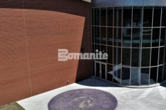 Bomanite Alloy was installed here with a beautiful blend of reflective aggregates to create a concrete paving surface that is highly durable and adds a unique sparkle to the outside of this school.
