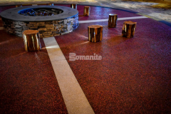 The colorful entrance inside the Choctaw Cultural Center was created by installing Bomanite Revealed glass aggregate decorative concrete, which is traditionally meant for exterior applications, but as the client desired an exposed look this application was the perfect choice to provide a rich and resilient finish for the entryway surfaces and the circle surrounding the firepit.