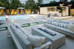 This sleek backyard patio and pool deck features Bomanite Sandscape Refined decorative concrete that was installed by our colleague Bomanite Toronto to create a durable surface for entertaining and their outstanding workmanship earned them the 2019 Honorable Mention Award for Best Bomanite Exposed Aggregate Project under 6,000 SF.
