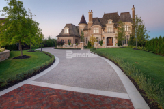 Bomanite Sandscape Texture is a highly durable and cost effective architectural concrete finishing option with natural non-skid properties and abrasion resistant aggregates and was the product of choice to create this residential driveway.