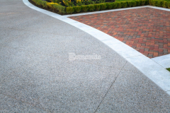 Bomanite Sandscape Texture decorative concrete was installed by our colleague Bomanite Toronto to create this stunning driveway and their stunning design and installation enhanced the aesthetic of the home, provided a durable paving surface, and earned them the Silver Award for Best Bomanite Exposed Aggregate Project.