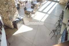 The hardscape plans at Gaylord Rockies Resort & Convention Center included Bomanite Exposed Aggregate Sandscape Texture decorative concrete that was installed in this space to add consistency amongst the interior flooring and exterior hardscapes of this native Coloradan built resort.