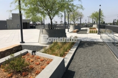 Bomanite Exposed Aggregate Sandscape Texture was utilized here to create a sandscape finish on these lineal planters and circular tree planters, adding beautiful texture that complements the geometrical arrangement of the pedestal pavers on this rooftop terrace and garden.