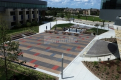 Bomanite Sandscape Texture was installed here with a detailed stain pattern that adds beautiful aesthetic appeal to the hardscape while complementing the surrounding architecture and creating visual continuity throughout the space.