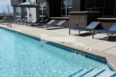 Bomanite Sandscape Texture was used to create the pool coping at the COLAB Co-Housing Development, offering a Sandscape finish and providing a child safety grip edge that coordinates well with the other hardscape finishes throughout this space.