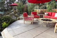 Stunning design detail was added to this decorative concrete hardscape by using the Bomanite Exposed Aggregate Antico process, creating a cost-effective finish with character and warmth in this cozy entertaining space.
