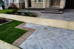 This beautiful driveway and patio feature Bomanite Yorkshire Stone imprinted concrete that perfectly complements the existing concrete walkway and provides the beauty of natural paving with the durability and affordability of concrete.