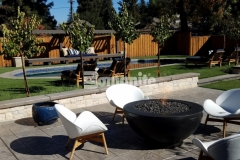 The design aesthetic of this backyard retreat is beautifully enriched by the Bomanite Sand Color Hardener and Bomanite French Gray Release Agent that were used in conjunction with Bomanite Bomacron imprinted concrete to create a durable and decorative hardscape surface.
