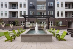 This beautiful gathering space at COLAB Co-Housing features a water fountain that was created using board-formed decorative concrete, which is well-suited as a finish material and showcases an imprinted wood grain that adds a modern and rustic elegance to this stylish student living community.