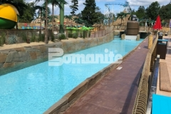This stamped concrete decking features the Bomanite Bomacron Boardwalk pattern and was used here to create a durable hardscape surface with dimension and texture that adds a beautifully distinctive design aesthetic to the lifeguard walk at this outdoor water park.