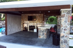 Bomanite Imprint Systems were installed here by our colleague, Concrete Arts, to create a distinctive, decorative concrete cabana flooring that was stamped with the Bomacron Slate Texture pattern, antiqued, and then color washed in a darker gray to create this perfect cozy retreat.