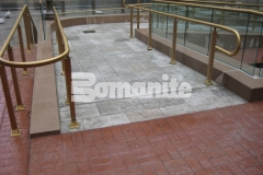 Bomanite Bomacron in the Medium Ashlar Slate pattern was installed here to create a pedestrian bridge and wheelchair access ramps and this durable and decorative concrete is a stunning design feature that perfectly complements the surrounding design elements.