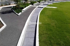 A water feature that stretches the length of Owasso's Redbud Festival Park along with a splash pad that emulates a riverbed of rock were created here by our colleague Bomanite of Tulsa, both of which feature the Bomacron Chipped Shale pattern in Cobblestone Gray and add distinct design detail to the hardscape.