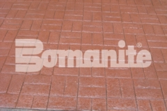 Connecticut Bomanite Systems' skillful and laborious installation of 31,450 square feet of Bomanite Basketweave Brick imprinted concrete earned them the 2018 Bomanite Imprint Systems Bronze Award and the finished product is a beautiful hardscape surface that blends beautifully with the surrounding design aesthetic.