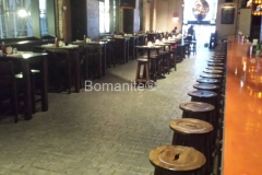 Beyond Concrete installed these stunning decorative concrete floors in the Stout NYC Bar and Restaurant, using Bomanite Thin-Set with a cobblestone pattern to renovate the flooring and provide an old world feel throughout the space.