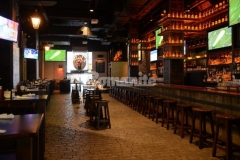 Beyond Concrete imprinted Bomanite Thin-Set to create this stunning cobblestone effect, providing a decorative concrete flooring surface that is durable and complements the old-world design aesthetic in the Stout NYC Bar and Restaurant.