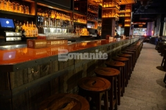 Beyond Concrete used Bomanite Thin-Set to create these distinctive decorative concrete floors and the custom concrete bar top that was stained with Bomanite Sweet Potato Concrete Dye to add a beautiful interplay of color and texture in the Stout NYC Bar and Restaurant.