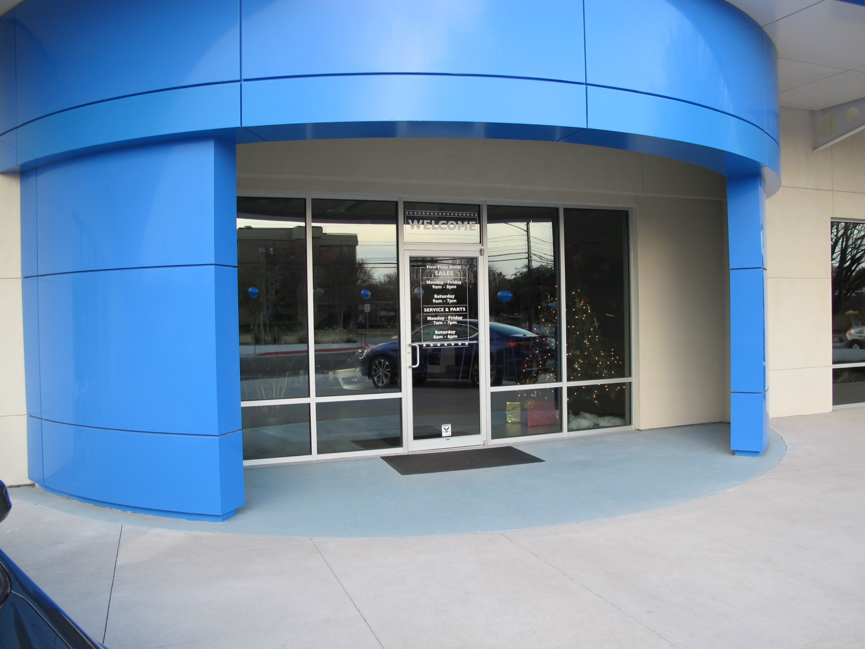 Bomanite Broadcast Aggregate Decorative Concrete Topping makes this Texas Honda Dealership Entrance stunning.