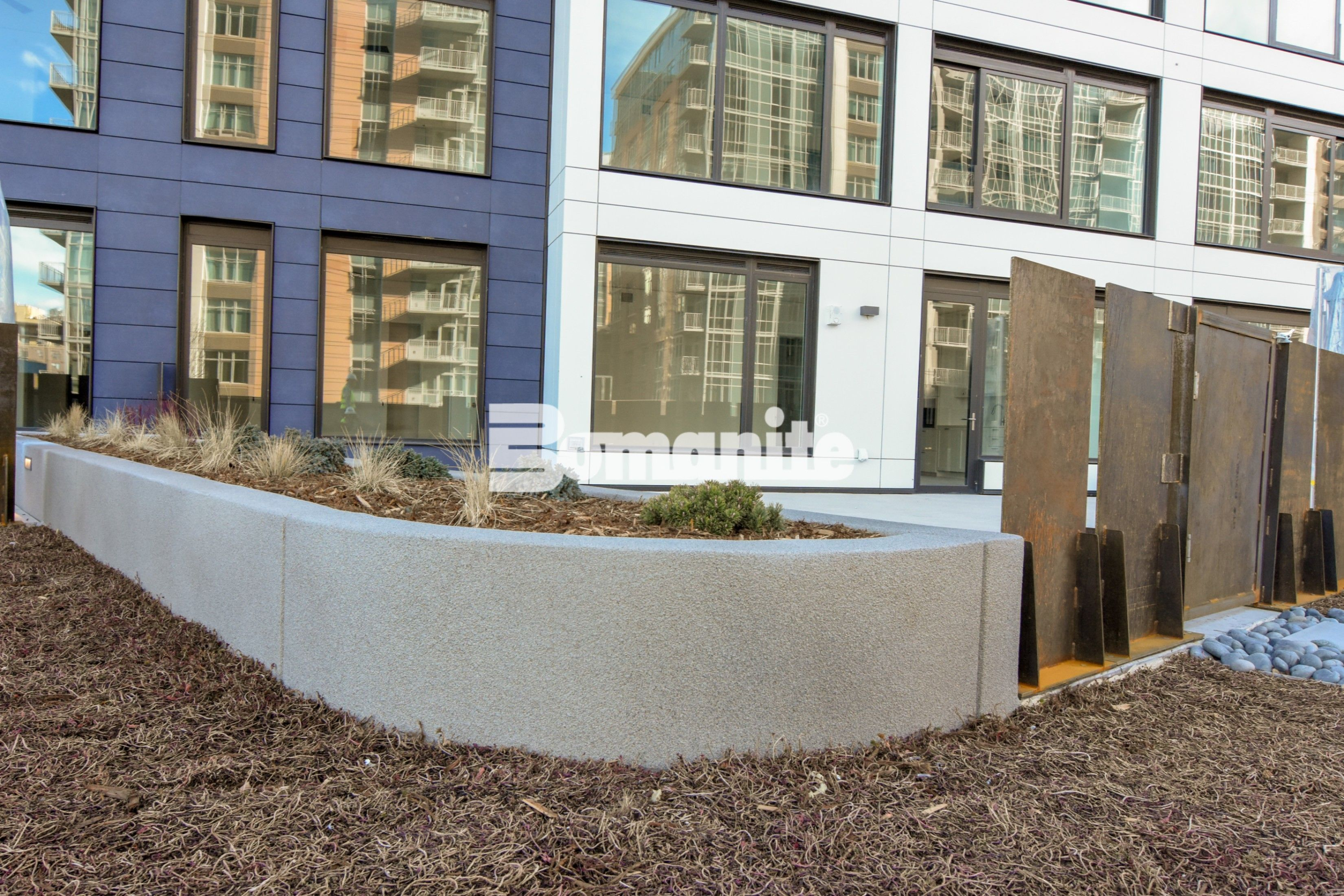 The Coloradan planters using Bomanite Toppings Systems with Bomanite Micro-Top ST and Sandscape finishes installed by Colorado Hardscapes in Denver, CO.