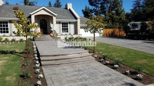 Front of the house of a private residence in Fresno, CA with decorative concrete installed by Heritage Bomanite using Bomanite Imprint Systems with English Sidewalk Slate Pattern.