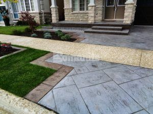 Closer view of the porch and steps with part of driveway in the foreground of Bomanite Imprint Systems decorative concrete installed using Yorkshire Stone Pattern and Bomanite Shale Gray Color Hardener installed at a residence in Burlington, Ontario, by Bomanite Toronto located in Vaughn, Ontario near Toronto Canada.
