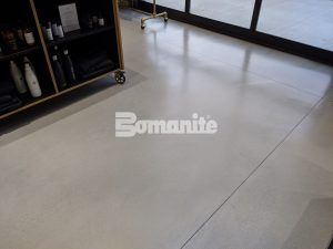 Another close up of the Bomanite Modena SL Custom Polished decorative concrete overlay flooring at Nickel & Suede installed by Musselman & Hall Contractors, LLC in Kansas City, MO.