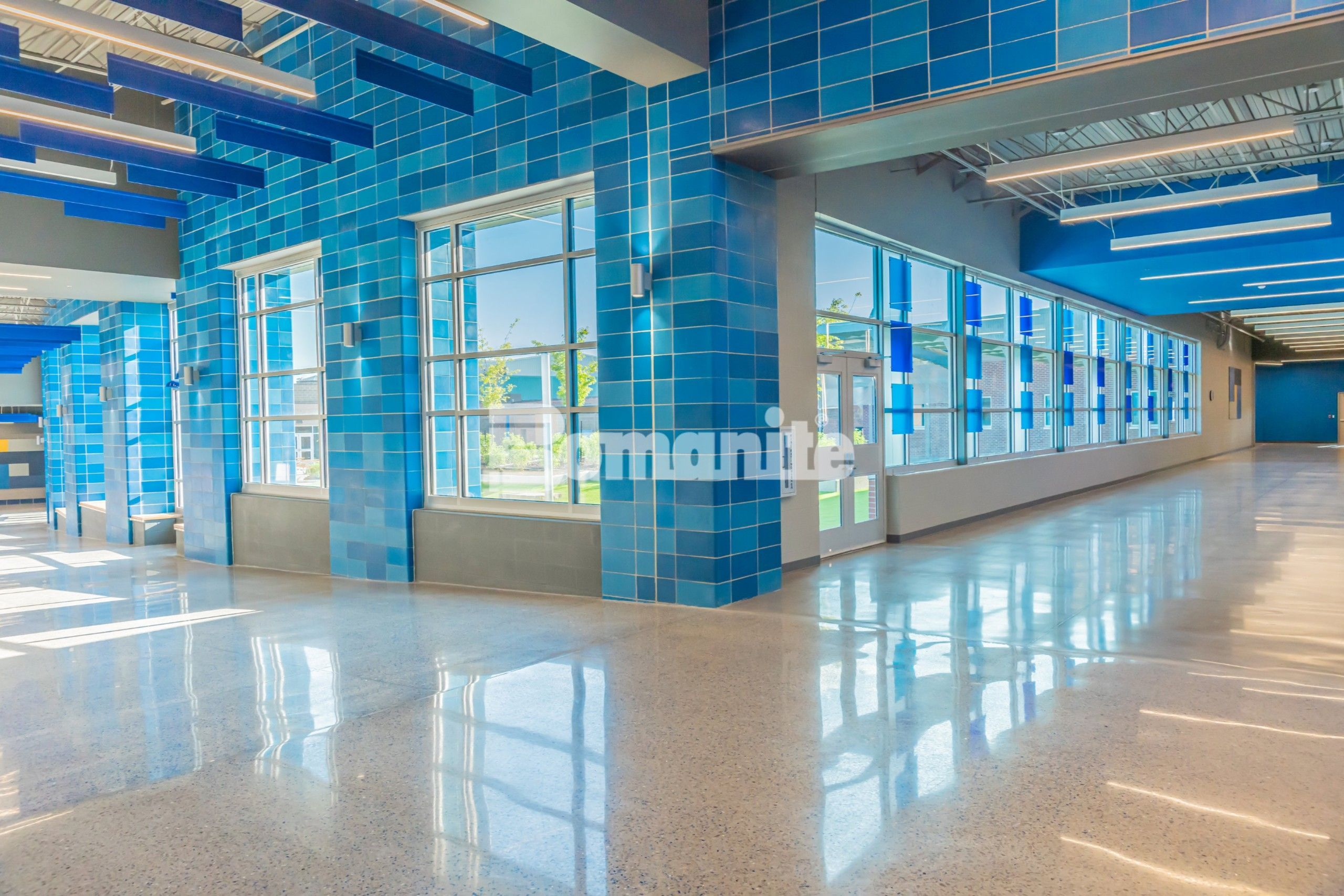 Main entrance of Grain Valley High School who worked with Hollis + Miller Architects to renovate and expand their rapidly growing community. Musselman & Hall Contractors installed the Bomanite Modena SL Custom Polishing System for their main entrance, hallways and other hard flooring surfaces.