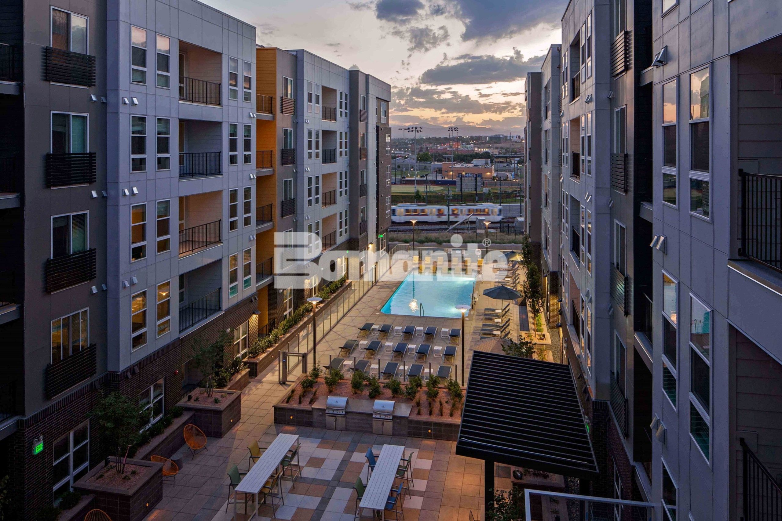 CoLab Student Living Housing Community in Denver built several outdoor gathering areas for tenants to enjoy, the pool court (Resort-Style Pool), Fire Court (Outdoor Lounge) and Water Court (Table Games) all featuring decorative concrete consisting of Bomanite Exposed Aggregate Systems, Bomanite Toppings Systems and Board Formed Concrete by Colorado Hardscapes.