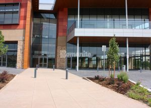 Front Entrance View of The Charles Schwab Conference Center at Ridgegate with Bomanite Imprint Systems in an English Sidewalk Slate Pattern for the Entry Way and surrounding drive areas installed by Colorado Hardscapes.