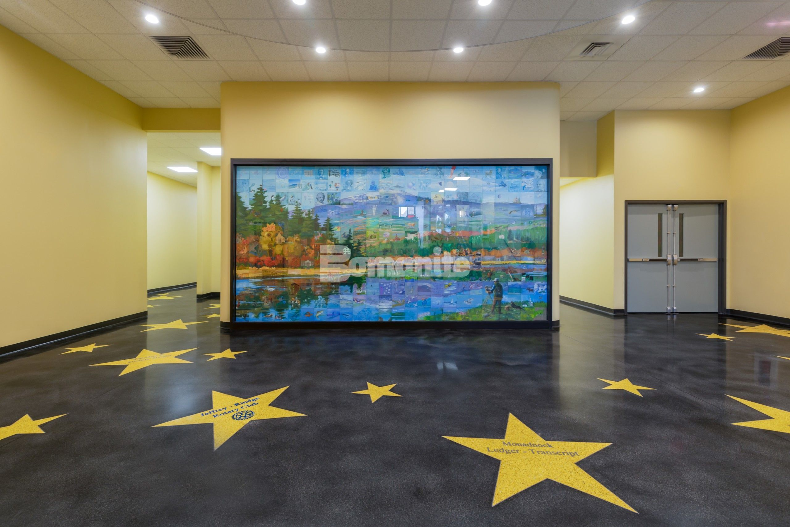 Premier Concrete Construction brought to life the Hollywood walk of fame in the main lobby of the Jaffrey Park Theatre in Jaffrey, NH, with a sleek dark Bomanite Renaissance Polished Concrete Floor as the background to the Golden Stars engraved with donor names in brilliant blue created with the Bomanite Modena TG system.
